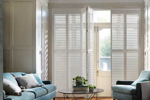tracked shutters for large areas available from brite blinds in sussex